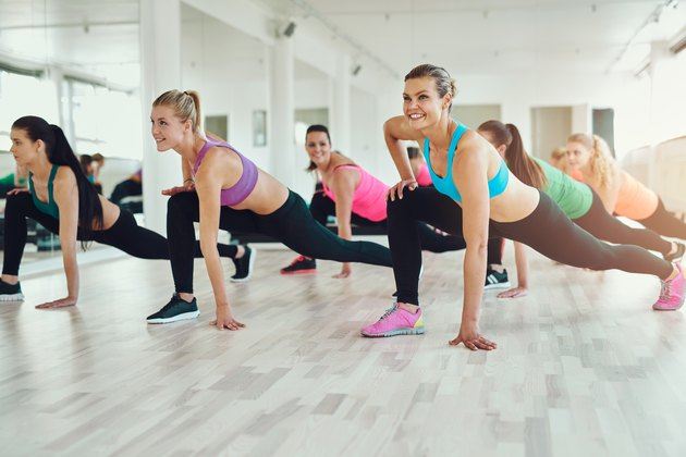 women in colourful sportswear exercising