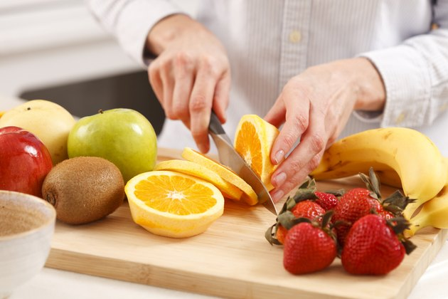 Woman slicing orange