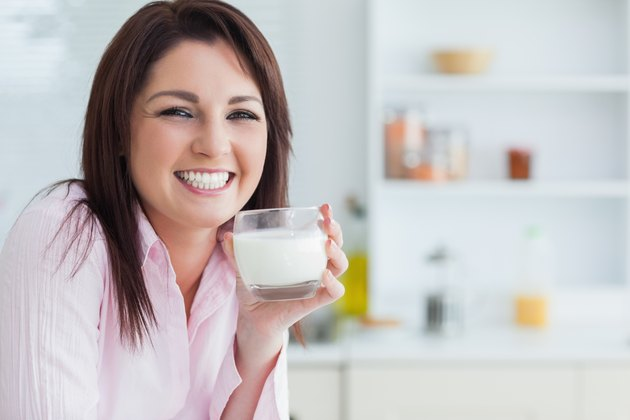 Portrait of woman with glass of milk