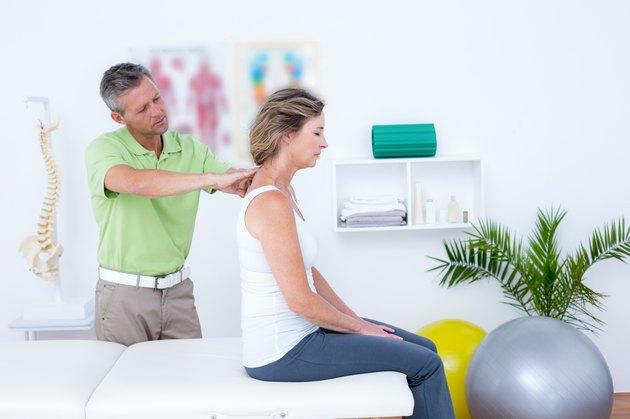 Doctor doing back adjustment
