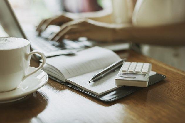 writer typing in a laptop