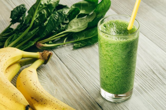 Green Smoothies of spinach and banana in a glass