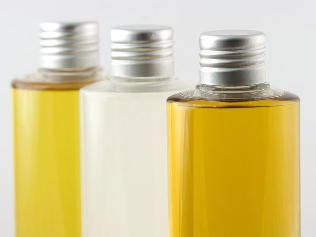 Bottles of PURE oil - Cold pressed olive, coconut, jojoba.