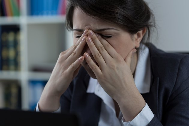 Business worker with sinus pain