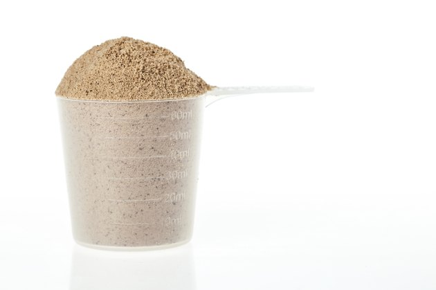 Scoop of chocolate whey protein powder
