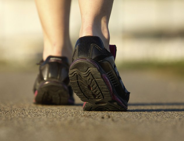 Sports female in black running shoes