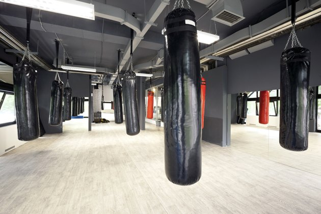 Punching bags in spacious gym