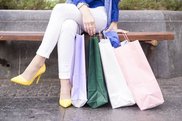 Shopping legs with her shopping bags and crossed legs