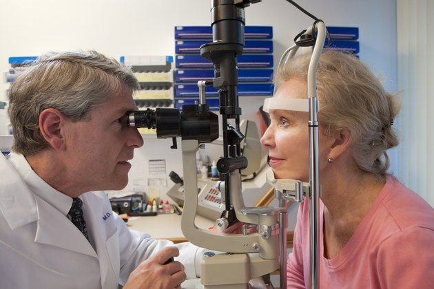 Ophthalmologist examining a woman's eyes with a slit lamp