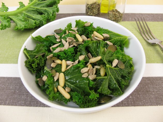 Kale salad with sunflower seeds, pine nuts, pumpkin seeds