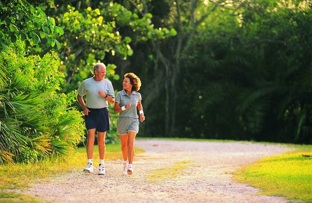 Hispanic senior couple jogging