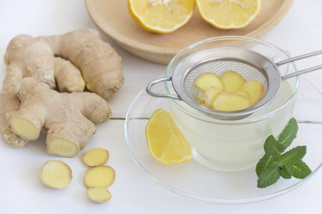 Ginger tea with lemon and mint in tea cup