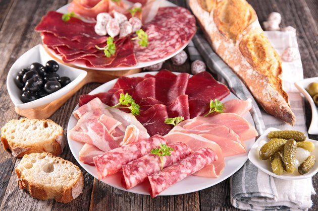 table with meat, bread, olive