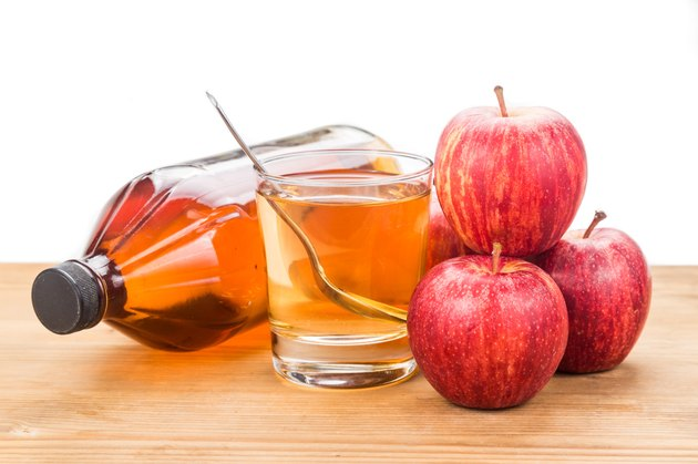 Apple cider vinegar with fresh apple as prop, healthy drink
