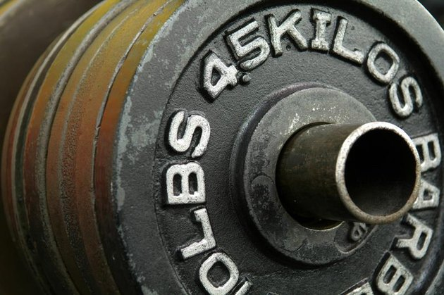 4.5-kilo weight plates on a rack.