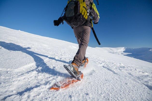 Snowshoeing in Carpathian mountains in wintertime