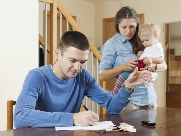 Family with baby having quarrel  over money