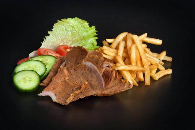 Kebab meat with fried potatoes and vegetables