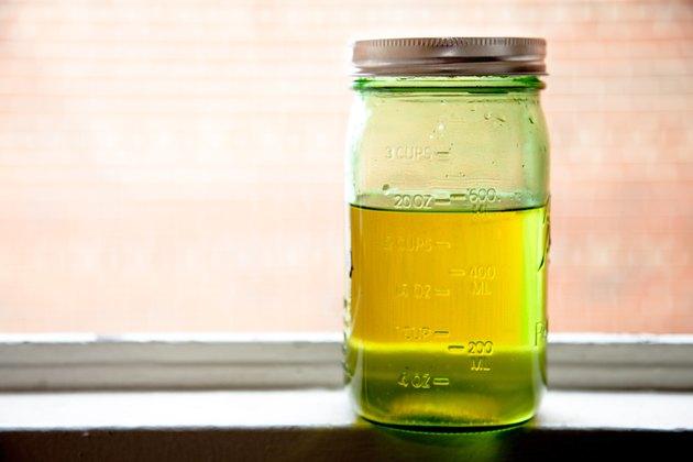 Organic oil jar on windowsill