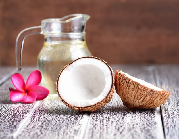 coconut oil isolated on wooden background.