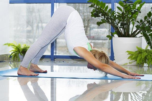 girl doing yoga and gymnastics in the hall