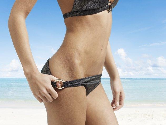 Midsection View of Woman Pulling Bikini Bottom