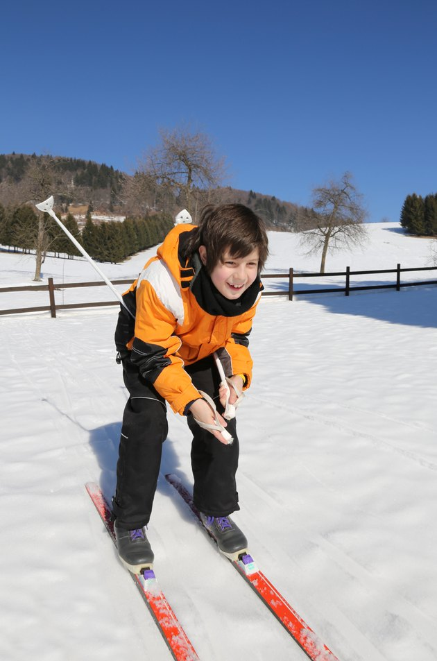 young boy goes on cross-country skis on the white snow