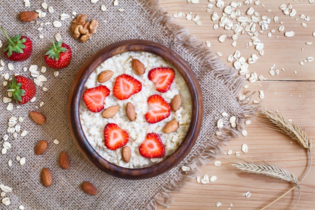 Healthy breakfast oatmeal porridge diet nutririon with strawberry and nuts