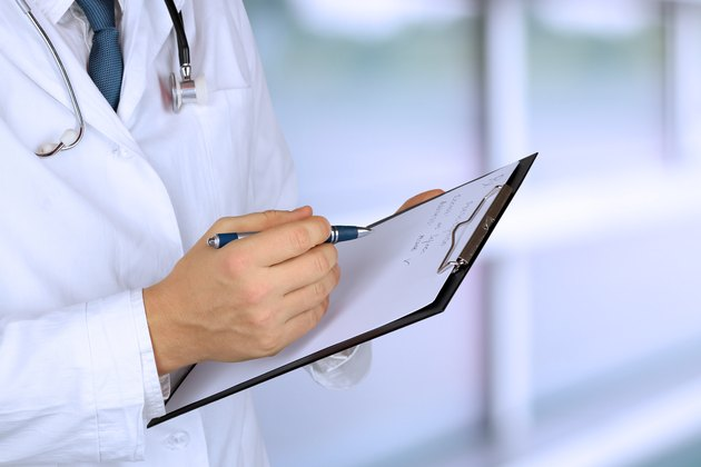medical doctor  with a stethoscope holding  a black folder