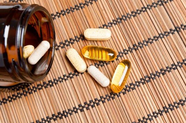 Multivitamin Pills in a brown medicine jar