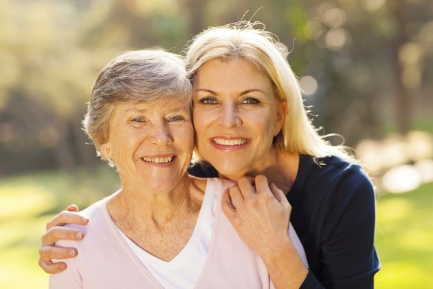 senior woman and middle aged daughter