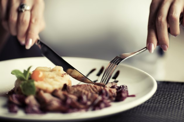 Female hands with a dinner at restaurant