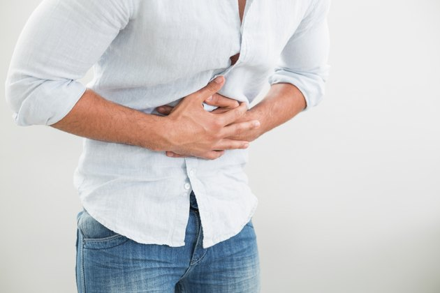 Mid section of man suffering from stomach pain