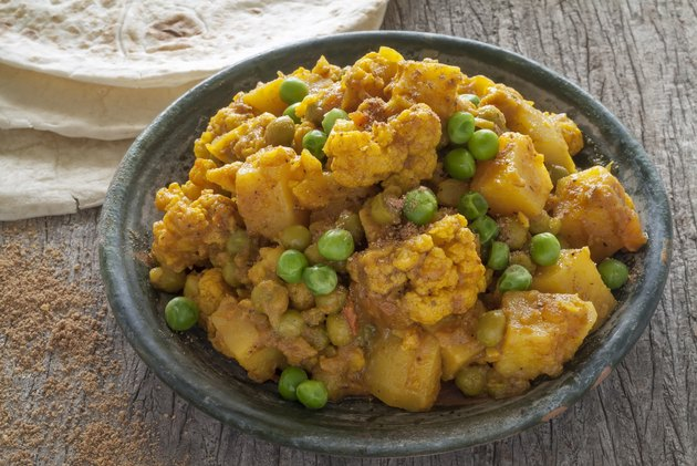 Cauliflower and Potato Curry with Green Peas Accompanied with Chapattis.