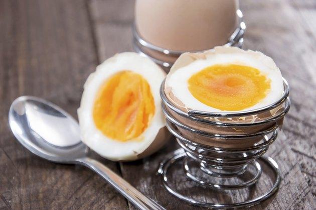Halved egg on wood