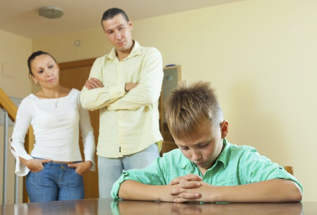 Parents  and teenager son having conflict