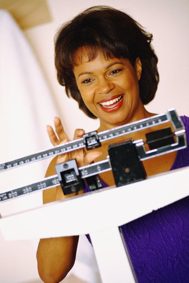 Woman balancing scale