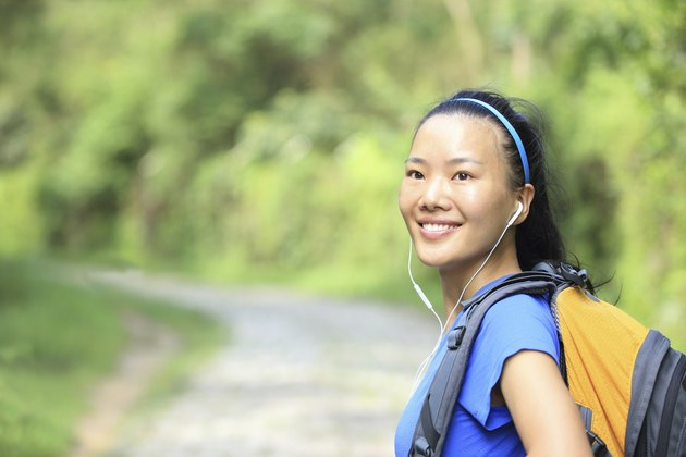 hiking woman on forest trail