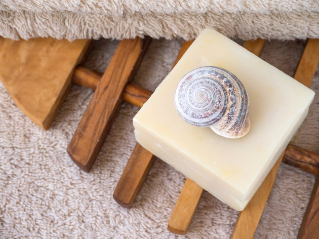 Natural soap bar, snail shell and terry towel