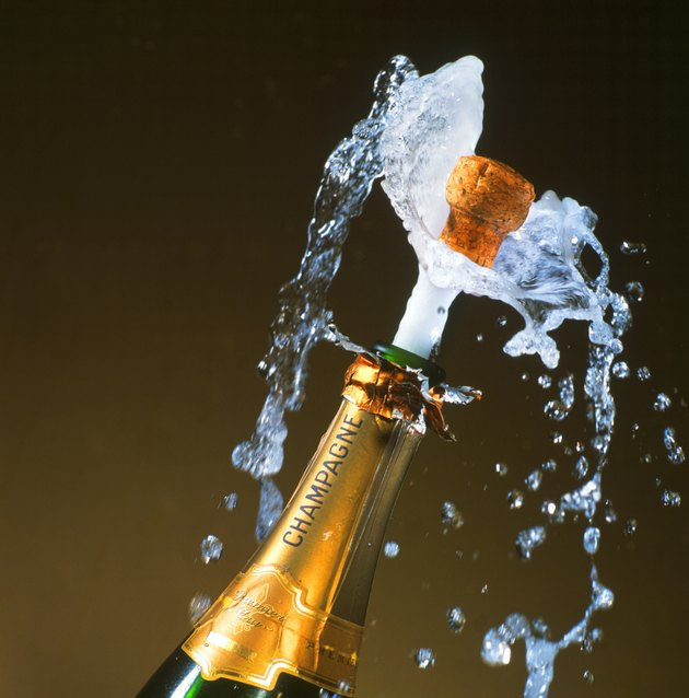 a champagne bottle with its cork shooting out