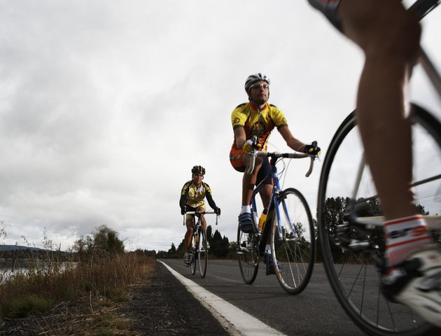 Road cyclists in action, surface level