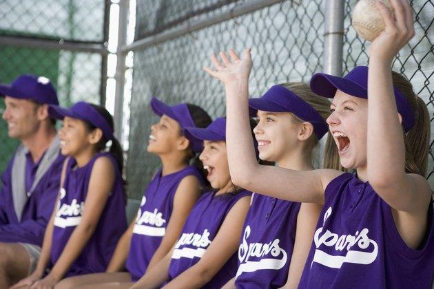 Little league team in dugout cheering