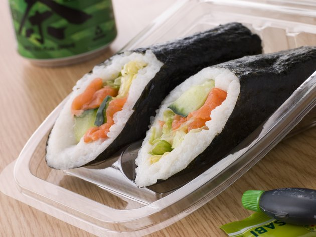 Hand Moulded Sushi With A Can Of Green Tea