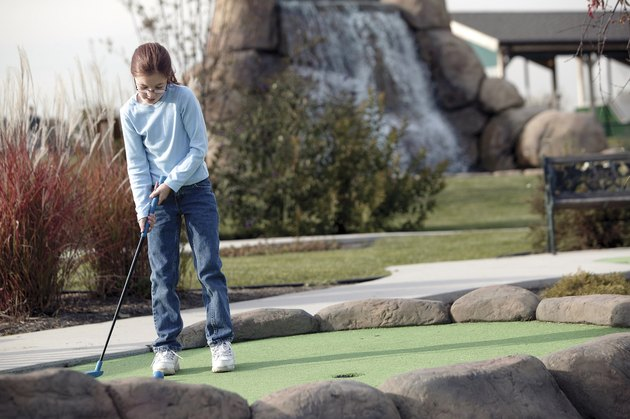 Girl practicing golf