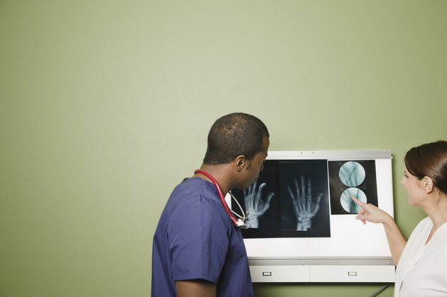 African doctor and nurse examining x-rays