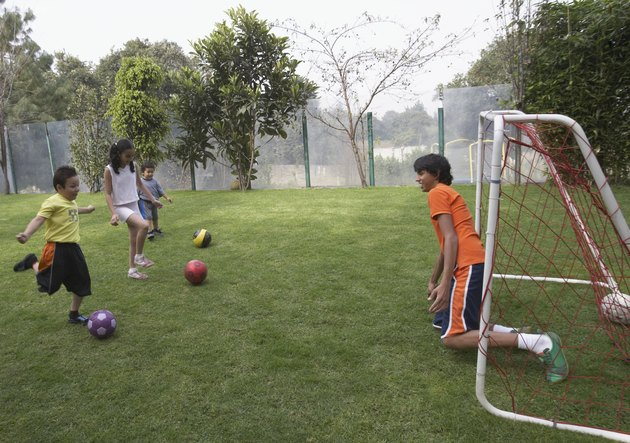 Group of children playing football
