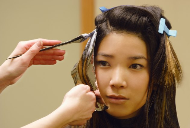 Closeup of woman getting hair foils