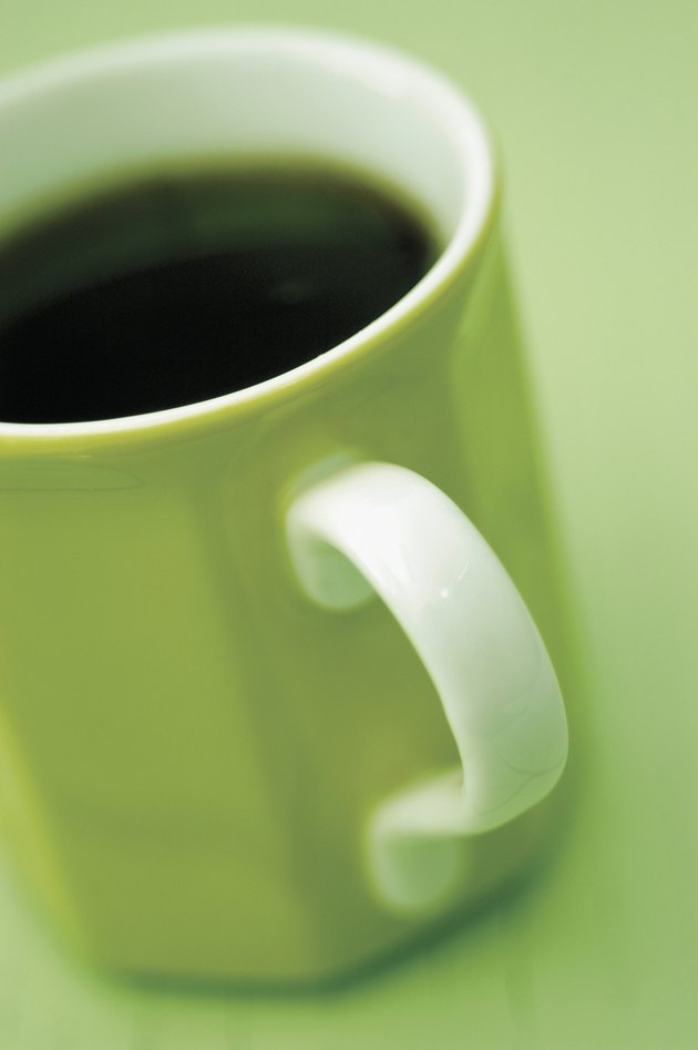 Black coffee in green mug