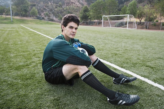 Soccer player sitting on field