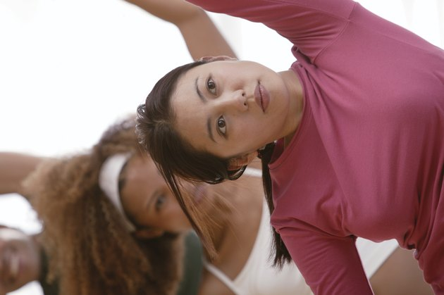 Woman stretching in aerobics class